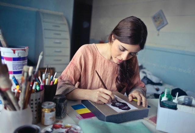 woman-in-brown-scoop-neck-long-sleeved-blouse-painting-933255